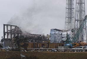 Smoke rises from Fukushima TEEOCO AP 295