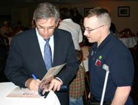 neocon war pig wolfowitz signs autograph for wounded soldier