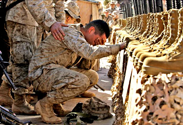 US Marine cries at memorial for fellow Marines