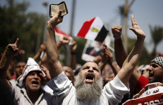 MB rally, with fundamentalists holding the Koran
