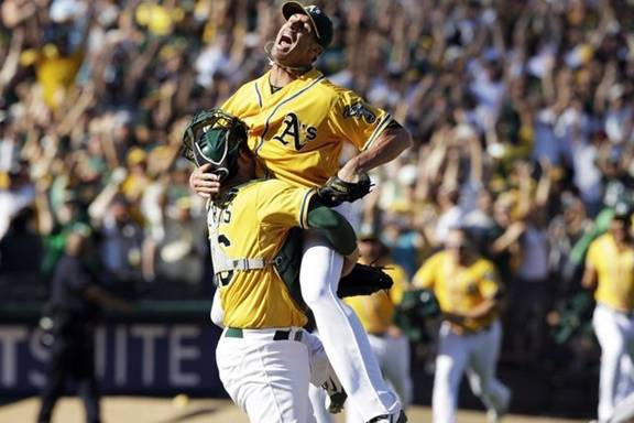 Closer Grant Balfour and Mike Norris celebrate another Oakland A's win