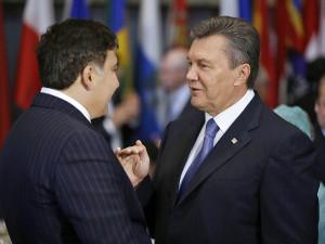 Viktor Yanukovych (R)