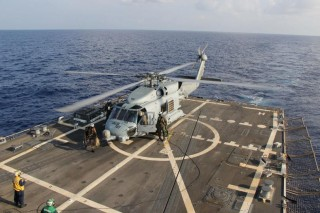 US Navy MH-60R Sea Hawk from Helicopter Maritime Strike Squadron assigned to the USS Pinckney (DDG-91), lands during a crew swap.
