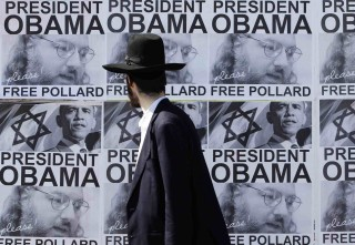 As the posters indicate, Obama would be serving the Israeli flag - not the American one - by freeing Pollard