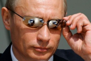 How does Putin conduct foriegn policy without threats, yet America seems hooked to that tactic?