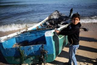 Fisherman's son on Gaza strip inspects boat