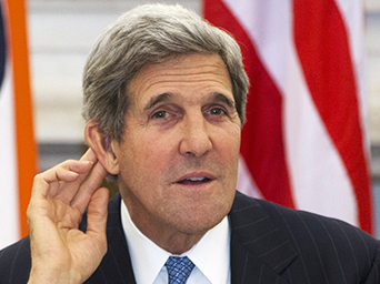 U.S. Secretary of State Kerry gestures as he asks reporter to repeat question during news conference with Indian Foreign Minister Khurshid at Hyderabad House in New Delhi