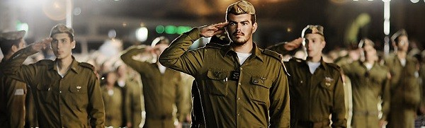 IDF officers from the Kfir infantry brigade saluting the Israeli flag