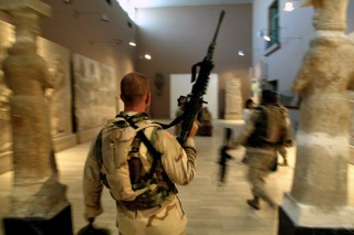 Two US soldiers from the 1st Division, 2nd Bridage, Texas, storming & looting the Iraq Museum 10 September 2003 in Baghdad