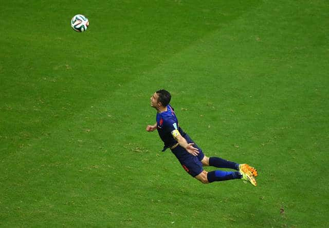 Robin van Persie of the Netherlands scores the team's first goal with a diving header in the first half during the 2014 FIFA World Cup Brazil Group B match between Spain and Netherlands at Arena Fonte Nova on June 13, 2014 in Salvador, Brazil. (Photo by Jeff Gross/Getty Images)