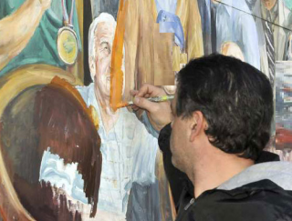 Painting a convicted pedophile out of a mural