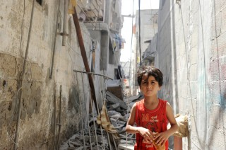 Gaza Residents Inspect Remains After Israeli Air Strikes