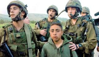 IDF soldiers apprehending a Palestinian boy