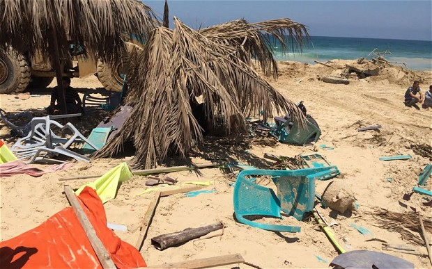 Remains of the Fun Time Beach bar at Khan Younis beach where nine friends were watching the World Cup when they were struck by a fatal Israeli strike Photo: ROBERT TAIT