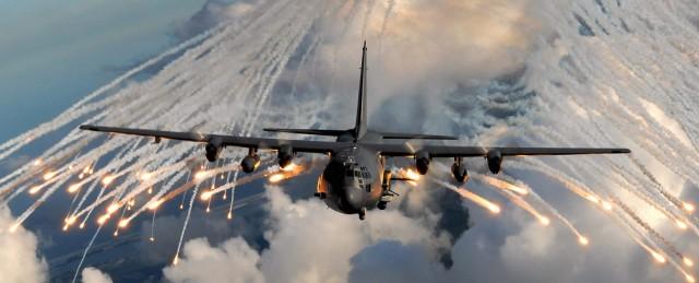 Lockheed Martin AC-130 Spectre gunship firing flares