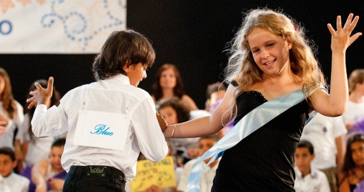 Israeli and Palestinian children being taught to dance together in Jaffa, Israel and in the process learning to co-exist in cooperation, admiration and mutual respect.