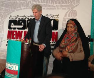 Press TV's Anchor, Marzieh Hashmemi introducing Dr. Gareth Porter