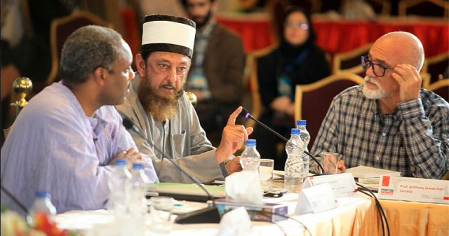 The author with Sheik Imran N. Hosein and Rev. Randy Short of Washington DC at the table of the formal proceedings of the The New Horizon Second International Conference of Independent Film Makers, Tehran, Sept. 29 to Oct. 1
