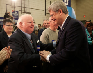 Senator Mike Duffy and Prime Minister Mike Duffy in Happier Times. CTV reporter was elevated to the Senate for violating his journalistic objectivity by openly campaigning for Harper While He Was Still a Journalist. Now Duffy is Charged with Accepting a Bribe from the Prime Ministers Office. The War on ISIL is helping Harper change the subject of political discourse in Canada.