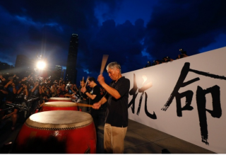 Founders of the Occupy Central civil disobedience movement, Rev Chu Yiu-Ming, Benny Tai and Chan Kin-man, play drums