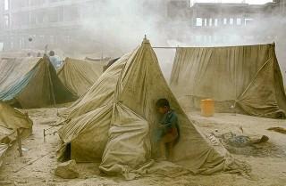 Afghani boy in refugee camp
