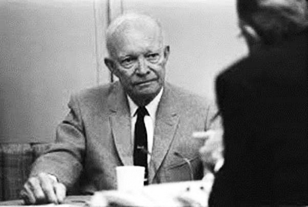 Eisenhower holding forth within Columbine Two