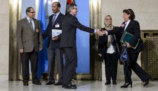 United Nations special envoy to Libya Bernardino León (C) welcomes representatives of Libya's warring factions prior to talks in Geneva, on January 14, 2015