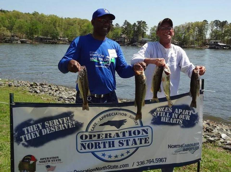 Wounded Warrior Derrick Mitchell, left, and fishing host Sherrill Bumgarner celebrate their catches during a Top Shelf Fishin' Festival at Badin Lake last April. Lake Norman will host the event for the first time next month. COURTESY OF TERRY SNYDER Read more here: http://www.charlotteobserver.com/news/local/community/lake-norman-mooresville/article12620441.html#storylink=cpy