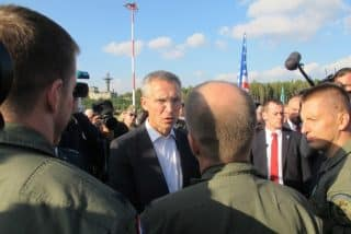NATO Secretary General Jens Stoltenberg meets with U.S. Air Force personnel at Lask air base in Poland