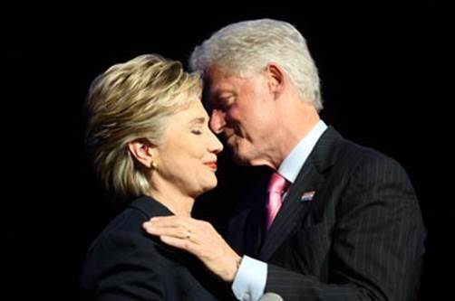 Hillary and Bill exchange a knowing political moment