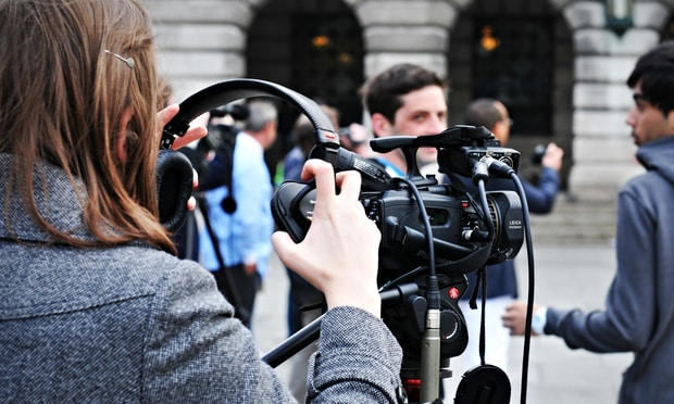 student journalist filming