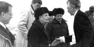 """Could Israeli agents within the U.S. government have deceived well-meaning scientists on both """"sides""""? The US public was told that America was helping make the world safer by doing ground-breaking work to secure nuclear materials. Here is Yuli Khariton (center), scientific leader of the Russian Federal Nuclear Center of the All-Russian Research Institute of Experimental Physics greeting Siegfried Hecker, Feb. 1992. (Photo courtesy of the Freeman Spogli Inst. for International Studies at Stanford Univ.)"""
