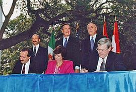 Back row, left to right: Mexican President Carlos Salinas de Gortari, U.S. President George H. W. Bush, and Canadian Prime Minister Brian Mulroney, at the initialing of the draft North American Free Trade Agreement in October 1992