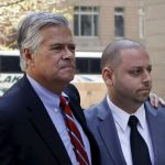 New York State Senator Dean Skelos (center L) hugs his son Adam Skelos while they arrive at the Jacob Javits Federal Building in New York May 4, 2015. New York Senate Majority Leader Dean Skelos, a Republican, was taken into custody by federal authorities on Monday morning as part of a public corruption matter, an FBI spokesman said. Skelos and his son, Adam, were seen by a Reuters photographer walking into the Federal Bureau of Investigation headquarters in lower Manhattan earlier in the day following reports that the two men would be charged criminally. REUTERS/Eduardo Munoz