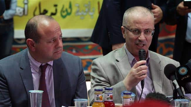 Palestinian Prime Minister Rami Hamdallah (R) speaks next to John Gatt-Rutter, the EU envoy to Palestine,