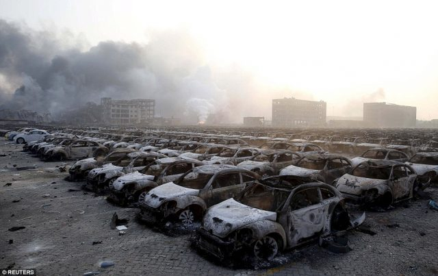 Thousands of burnt-out Volkswagen Beetles close to ground zero in Tianjin.
