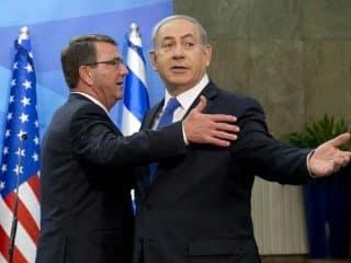 Ashton Carter waits for his hug from Binyamin Netanyahu