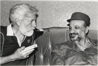 A white haired Uri with Arafat in 1982 in Beirut