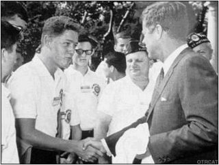 A young Bill Clinton meeting JFK