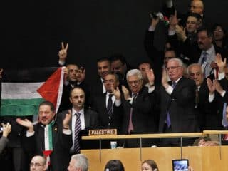 President of the Palestinian National Authority Mahmoud Abbas, center, celebrates with members of his delegation and other supporters at the UN General Session