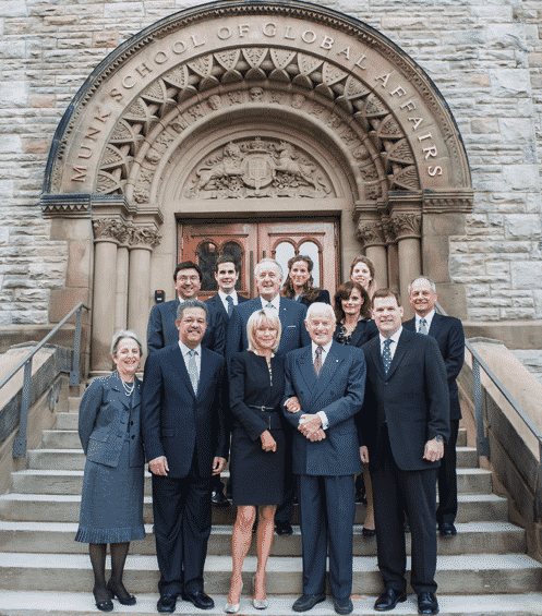 Some Prominent Canadian Members of Barrick's Barricudas Pose in Front of the Entrance Way to the Munk School of Global Affairs at the University of Toronto.. Cozying up to Peter Munk on His Left is Then Foreign Affairs Minister John Baird. Baird Tried to Defend Nigel Wright in 2012 When the PM's Chief of Staff Stood Accused of Exploiting His Access to Harper to Advance Barrick's Interests. In 2015 Baird Would Hand Over $9 million in Public Funds to the Munk School Before Joining Barrick's International Advisory Board. The Current Chair of That Board is Brian Mulroney Pictured in the Centre. Flanking Mulroney is Former U of T President, David Naylor, Now a Member of the Board of Barrick Gold, and the Current U of T President Meric S. Gertler.