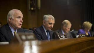 Senate Armed Services Committee Chairman Sen. John McCain, left, questions Gen. Austin on Wednesday