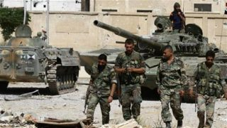 The file photo shows Syrian army forces in the border town of Zabadani, about 46 kilometers (29 miles) northwest of the capital, Damascus.