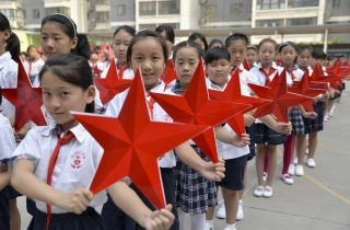 Students pose with red stars