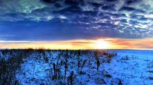 Winter plain, clouds and sunset