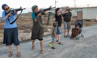 Jewish settlers train with weapons
