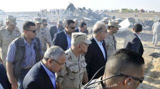 Egypt's Prime Minister Sherif Ismail (C) and Egypt's Defense Minister Sedki Sobhi (2nd L) arrive at the crash scene