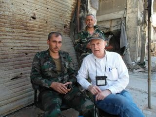 Jim Dean in Homs, Syria on election day, June 2014, at checkpoint