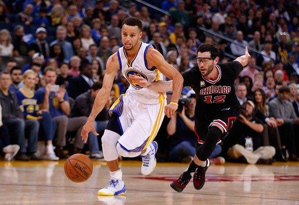 Stephen Curry in action / Golden State Warriors 2009 - present